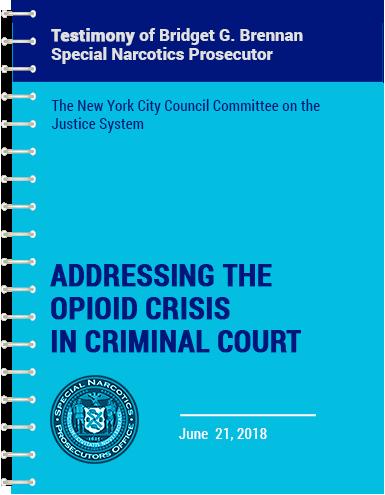 opiod crisis report in a notebook binder